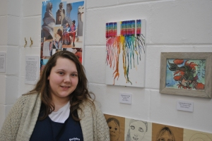 Cassandra with her art on display