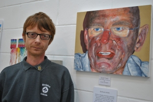Gareth with his art on display
