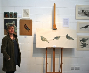 Louise Banks with her bird paintings in the Exhibition